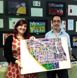 Briony and James with student artwork