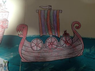 a longship with added Viking