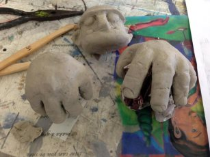 big hands also made from paper clay