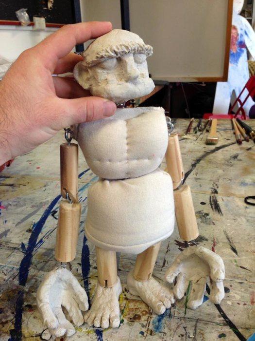 fabric torso, wooden limbs, paper clay head/hands/feet
