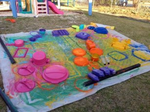 sparay-painting pots and pans for the music play area