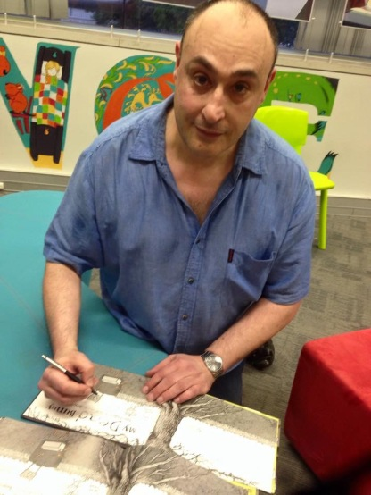 Sigi signing his book