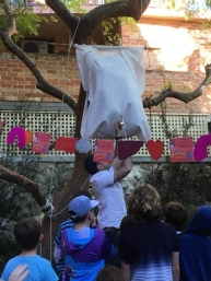 A giant nappy, hanging from a tree